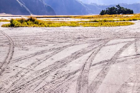 Wheel marks on the ground at Mount Bromo volcano, in East Java, Indonesia. Imagens