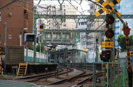 View of Japanese train railroad crossing Editorial
