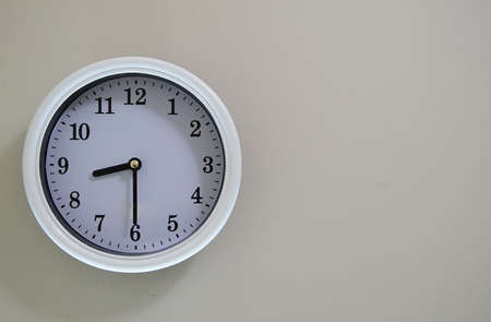 Wall clock time is 8:30. Stock Photo