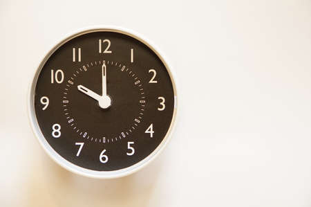 The time for wall clock of the room is indication of 10:00