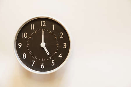 The time for wall clock of the room is indication of 5:00