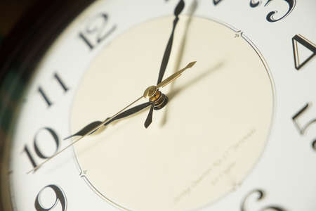 A clockface and hand of the clock Stock Photo