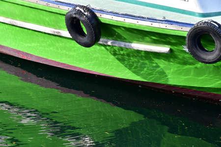 A green ship anchored at the port