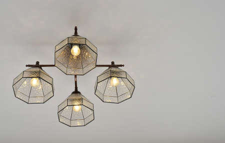 Lighting fixtures suspended from the ceiling of the room