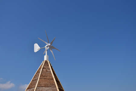 Scene of a windmill and the blue sky on the roof