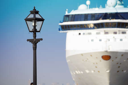 Scene of the streetlight of the port and the anchoring passenger ship