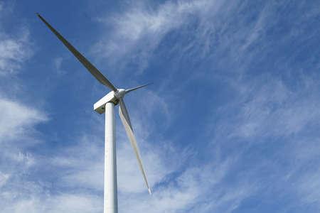 Wind generator blade in sunny blue sky day 写真素材