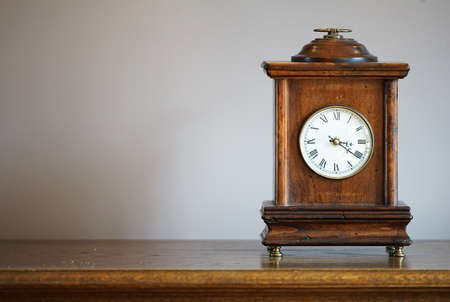 Table clock of the old wooden frame of the room