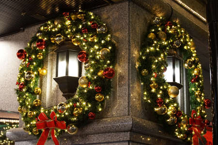 Christmas wreath decorated with street lights on the streets of the city at night