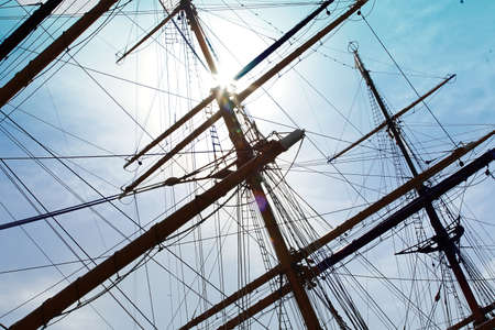 The blue sky and the mast of the sailing ship on a clear day