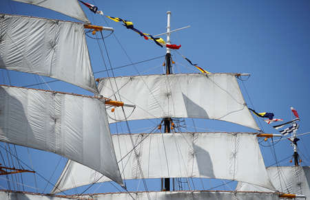 A mast and sail of the sailing boat of the day when it was fine