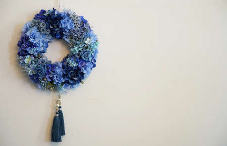 The blue garland which was hung on the wall of the room