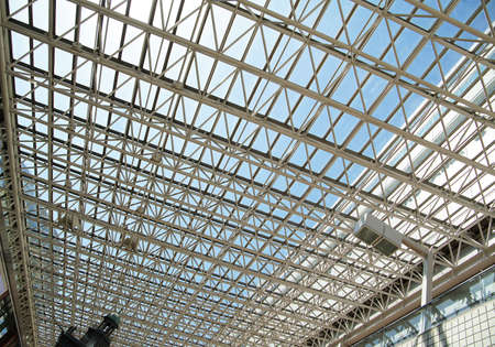 Roof of the big glass and steel frame of the day of the blue sky which it was fine