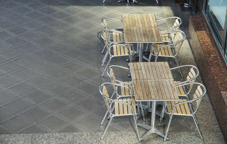 A chair and table of the open space of the park of the day when it was fine 写真素材