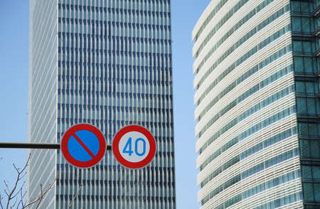A high-rise building and traffic sign of the day when it was fine