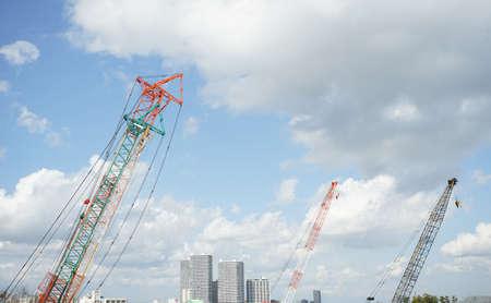 construction site crane and sunny blue sky