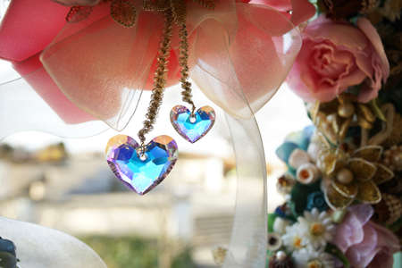 A flower and crystal of the heart which were displayed to the window of the room