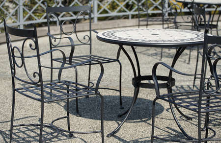 A table and chair of the garden of the day when it was fine