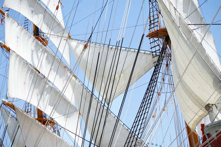 Three angles of sail and ropes of the sailing boat of the day when it was fine 写真素材