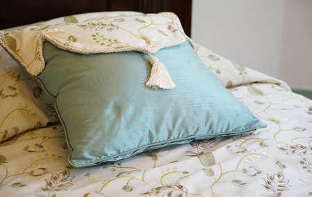 Blue cushion on the bed 写真素材