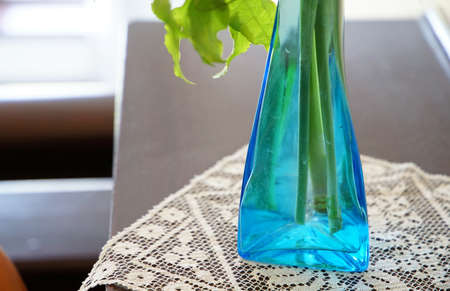 Blue glass vase on the table of the room