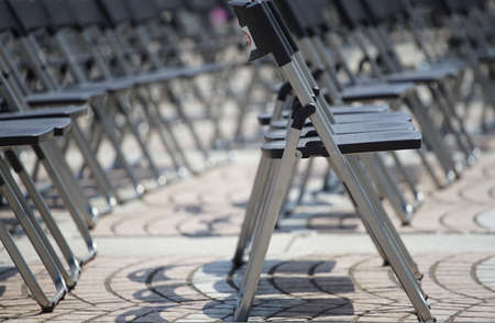 Many chairs which were displayed at the ground of the open space of the day when it was fine 写真素材