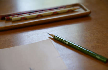 Writing implements of a pencil and the paper on the desk 写真素材