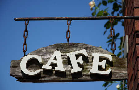Cafe shop sign of the blue sky which it was fine