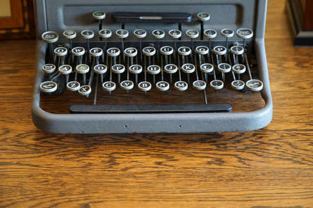 Old typewriter of the wooden desk