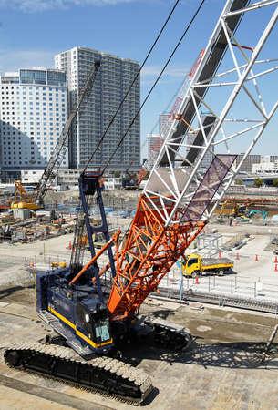 Large crane of the urban development construction site