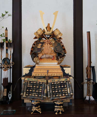 An armor and the helmet for the battle of the old Japanese samurai and a Japanese sword and bow