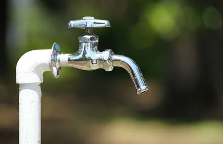 Faucet in the park drinking fountain on a sunny day