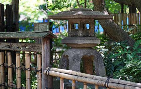 Japanese garden lantern and bamboo fence 写真素材