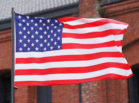 The United States of America national flag which streams in the wind of the day when it was fine
