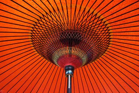 The framework of a red Japanese umbrella