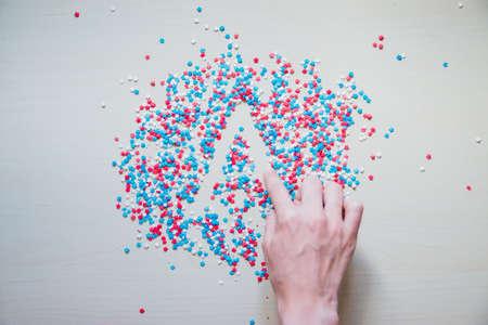 strewed: colorful sprinkles stars on palm