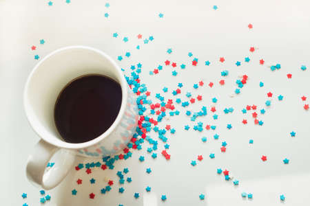 flatly: sprinkles stars around a cup of coffee Stock Photo