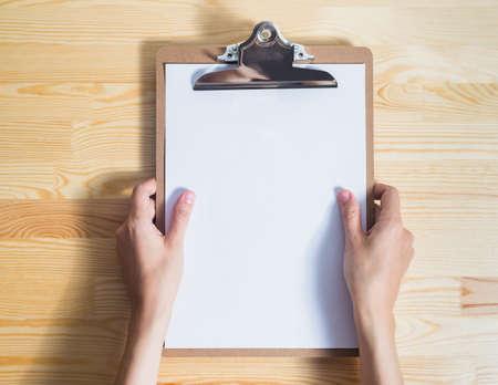 flatly: blank sheet on wooden background