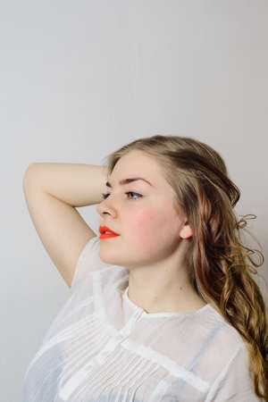 emotionless: emotionless young woman posing on a white background Stock Photo