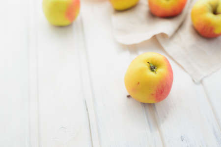flatly: apples on a white rag on the gray wooden background Stock Photo