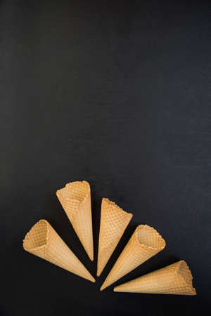 flatly: top view of Wafer cups for ice-cream on black slate table Stock Photo