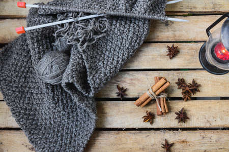 flatly: autumn comfort concept, still life of candlestick and knitting