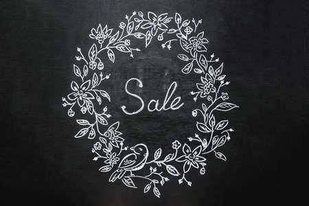 flatly: headline sale written in chalk on a blackboard Stock Photo