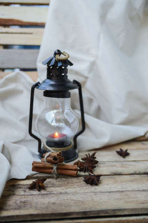 star life: autumn comfort concept, still life of candlestick, cinnamon and star anise