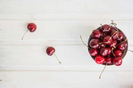 flatly: cherries in bowl and near on white background
