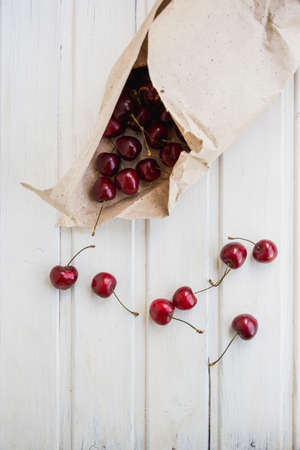 flatly: cherries in kraft and near on white background Stock Photo