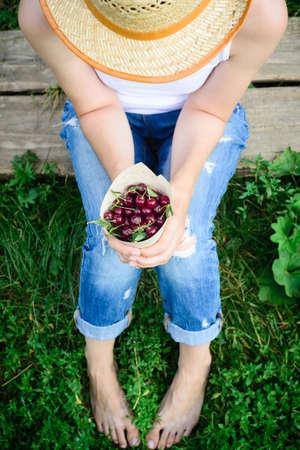 rustic harvester woman and fresh ripe cherries Stock Photo