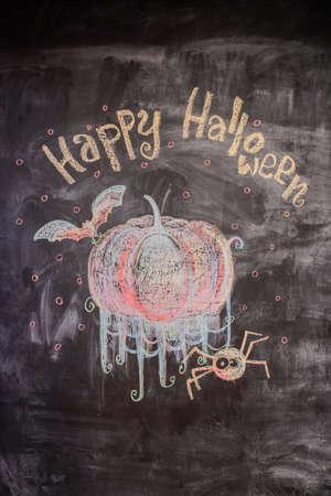 Chalk pattern of happy halloween on slate