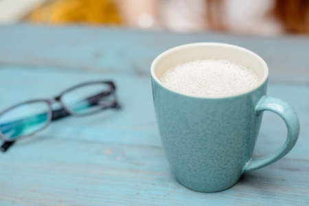 Coffee cup on blue rustic background Stock Photo