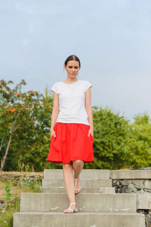 concrete steps: Brunette walk in the park on the concrete steps of terrace Stock Photo